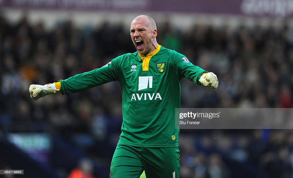 Norwick keeper <a gi-track='captionPersonalityLinkClicked' href=/galleries/search?phrase=John+Ruddy&family=editorial&specificpeople=822348 ng-click='$event.stopPropagation()'>John Ruddy</a> celebrates the opening goal during the Barclays Premier League match between West Bromwich Albion and Norwich City at The Hawthorns on December 7, 2013 in West Bromwich, England.