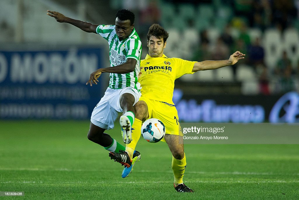 Nosa Iglebor of Real Betis Balompie competes for the ball with Manuel Trigueros of Villarreal CF during the La Liga match between Real Betis Balompie and Villarreal CF at Estadio Benito Villamarin on September 29, 2013 in Seville, Spain.