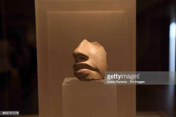 Nose and mouth from a statue of King Akhenaten made from Indurated limestone Tell elAmarna about 13451335 BC at the Ashmolean Museum in Oxford as it...