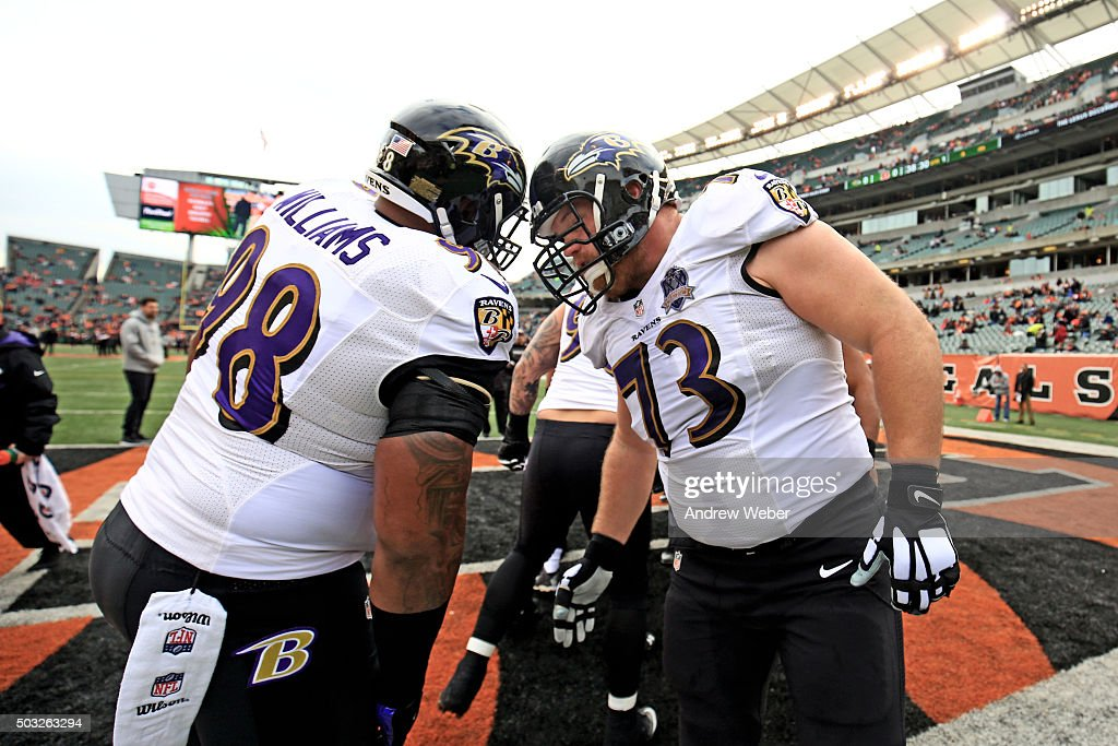 Nose tackle Brandon Williams #98 and guard <a gi-track='captionPersonalityLinkClicked' href=/galleries/search?phrase=Marshal+Yanda&family=editorial&specificpeople=2206873 ng-click='$event.stopPropagation()'>Marshal Yanda</a> #73 of the Baltimore Ravens prior to the game against the Cincinnati Bengals at Paul Brown Stadium on January 3, 2016 in Cincinnati, Ohio.