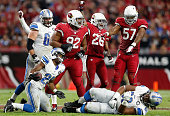 Nose tackle Dan Williams free safety Rashad Johnson and outside linebacker Alex Okafor of the Arizona Cardinals celebrate after a defensive stop...