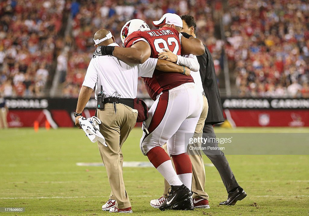 Nose tackle Dan Williams #92 of the Arizona Cardinals is helped off the field after an injury to his ankle during the preseason NFL game against the San Diego Chargers at the University of Phoenix Stadium on August 24, 2013 in Glendale, Arizona.