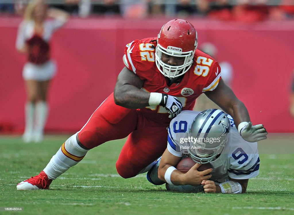 Nose tackle <a gi-track='captionPersonalityLinkClicked' href=/galleries/search?phrase=Dontari+Poe&family=editorial&specificpeople=6351064 ng-click='$event.stopPropagation()'>Dontari Poe</a> #92 of the Kansas City Chiefs tackles quarterback <a gi-track='captionPersonalityLinkClicked' href=/galleries/search?phrase=Tony+Romo&family=editorial&specificpeople=756503 ng-click='$event.stopPropagation()'>Tony Romo</a> #9 of the Dallas Cowboys after a short gain during the second half on September 15, 2013 at Arrowhead Stadium in Kansas City, Missouri. Kansas City defeated Dallas 17-16.
