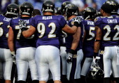 Nose tackle Haloti Ngata of the Baltimore Ravens huddles up with the team before taking on the Cincinnati Bengals at MT Bank Stadium on November 20...
