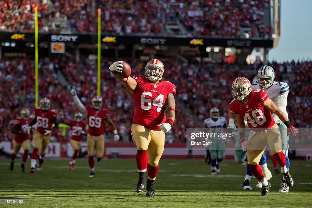Nose tackle <a gi-track='captionPersonalityLinkClicked' href=/galleries/search?phrase=Mike+Purcell&family=editorial&specificpeople=9693644 ng-click='$event.stopPropagation()'>Mike Purcell</a> #64 of the San Francisco 49ers scores a 37-yard touchdown on an interception against the Dallas Cowboys in the second quarter of a preseason game on August 23, 2015 at Levi's Stadium in Santa Clara, California. The 49ers won 23-6.