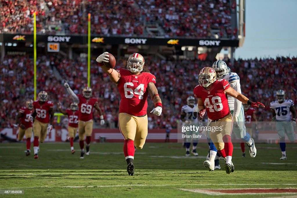 Nose tackle Mike Purcell #64 of the San Francisco 49ers scores a 37-yard touchdown on an interception against the Dallas Cowboys in the second quarter of a preseason game on August 23, 2015 at Levi's Stadium in Santa Clara, California. The 49ers won 23-6.