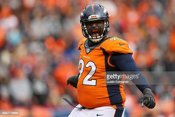 Nose tackle Sylvester Williams of the Denver Broncos celebrates in the second quarter of the game against the Oakland Raiders at Sports Authority...