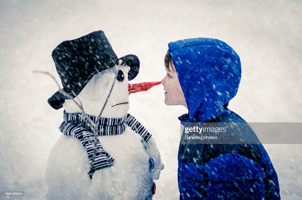 Nose to nose with a snowman : Stock Photo