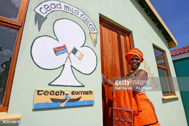 Nosipho Ngexe celebrates after receiving the keys to her first home in Wallacdene Township in Capetown after living in a shack for 15 years