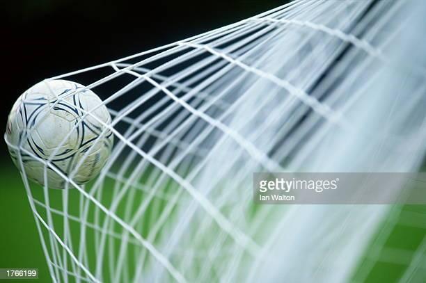 Soccer ball in net closeup