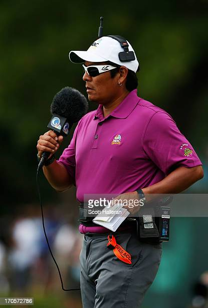 Notah Begay III analyst for Golf Channel watches play during Round Two of the 113th US Open at Merion Golf Club on June 14 2013 in Ardmore...