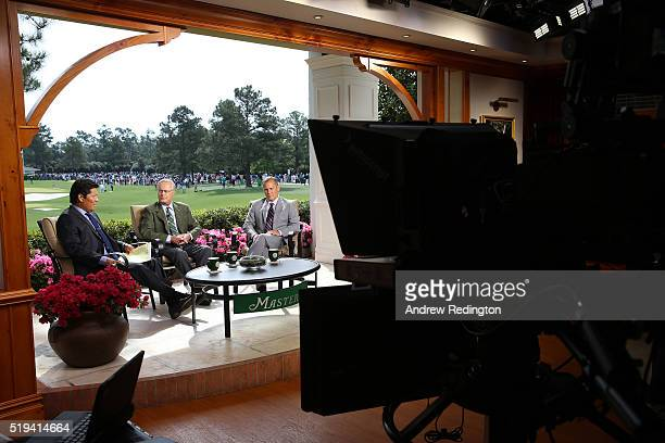 Notah Begay Mark Rolfing Steve Sands of the Golf Channel talk during a practice round prior to the start of the 2016 Masters Tournament at Augusta...