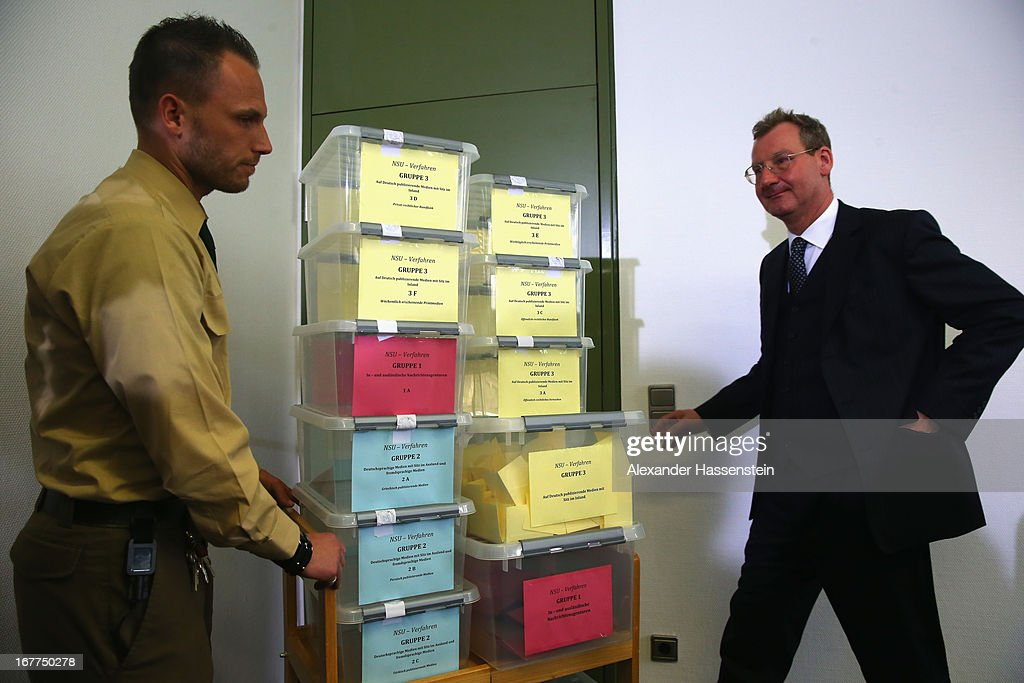 Notary Dr. Dieter Mayer and a police officer stands next to the lottery boxes after a press conference following the lottery draw for the 50 media spots inside the courtroom for the upcoming NSU murder trial on April 29, 2013 in Munich, Germany. This the second accreditation process for the trial, which manay analysts are dubbing the trial of the decade and is scheduled to begin May 6, after lawsuits filed by Turkish media were upheld and the Munich court responded by redoing all accreditations. Eight of the ten victims of the NSU neo-Nazi murder trio were Turkish and one was Greek, and Turkish and Greek media are now guaranteed a small portion of the 50 seats reserved for media after no foreign media were given seats in the first accreditation process.