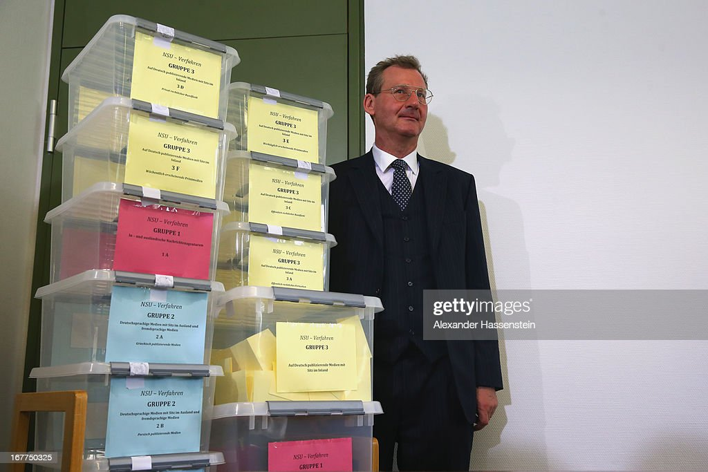 Notary Dr. Dieter Mayer stands next to the lottery boxes after a press conference following the lottery draw for the 50 media spots inside the courtroom for the upcoming NSU murder trial on April 29, 2013 in Munich, Germany. This the second accreditation process for the trial, which manay analysts are dubbing the trial of the decade and is scheduled to begin May 6, after lawsuits filed by Turkish media were upheld and the Munich court responded by redoing all accreditations. Eight of the ten victims of the NSU neo-Nazi murder trio were Turkish and one was Greek, and Turkish and Greek media are now guaranteed a small portion of the 50 seats reserved for media after no foreign media were given seats in the first accreditation process.