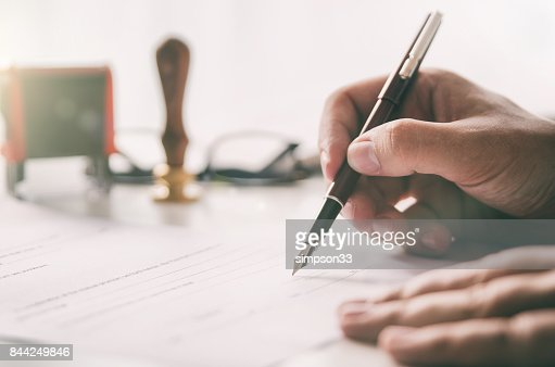 Notary signs legal contract. Businessman working in office : Stock Photo