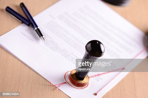 Notary's public pen and  stamp on testament : Stock Photo
