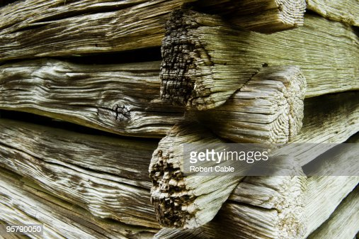 Notched, weathered logs on a historic cabin.