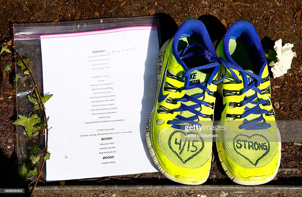 A note and a pair of shoes are left at the site of the second bomb along Boylston Street near the finish line of the Boston Marathon prior to the start of the B.A.A. Tribute Run on April 19, 2014 in Boston, Massachusetts.