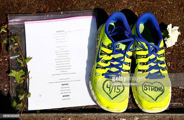 A note and a pair of shoes are left at the site of the second bomb along Boylston Street near the finish line of the Boston Marathon prior to the...