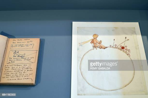 A note book belonging to artist Antoine de SaintExupéry and a drawing are on display at the Museum of Old Toulouse on May 17 prior to the set of 12...