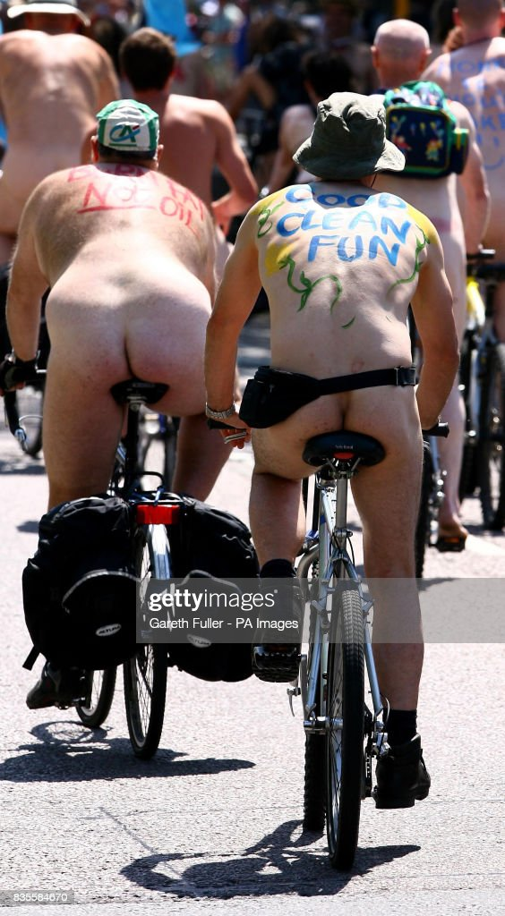 Note content. Participants in the Brighton leg of the World Naked Bike Ride move through the streets of Brighton, East Sussex to demonstrate the vulnerability of cyclists on the road and to protest against oil dependency.