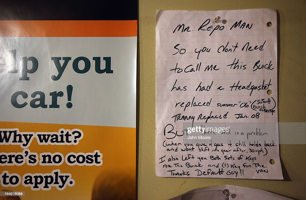 A note left by a former car owner hangs on the wall of Advanced Recovery of New York on October 11, 2012 in Syracuse, New York. Recovery agents, knows as 'repo men' work day and night locating and towing vehicles legally repossessed by banks and loan agencies, after the owners stop making payments.