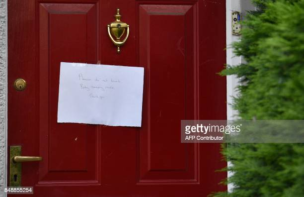 A note on a front door to a house reads 'Please do not knockBaby Sleeping' near to a police cordon by a house in Sunbury west of London on September...