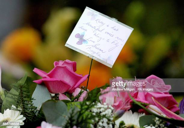 A note on flowers by Susan Boyle sits next to the coffin of former X Factor finalist Kerry McGregor at her funeral at the Kirk of Calder in Mid...