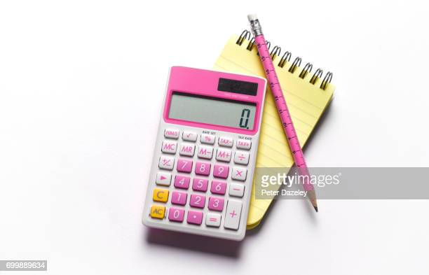Note pad and pink calculator and pencil