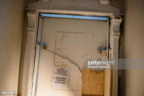 A note reading 'The mosque is permanently closed' is pictured on a door of the 'Fussilet 33' mosque in Berlin on February 28 2017 German authorities...