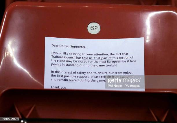 A note urging Manchester United fans to remain seated during their European cup tie against SK Sturm Graz during the Champions League Group A game at...