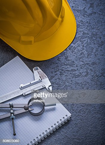 Notebook building helmet drawing compass vernier scale construct : Stock Photo