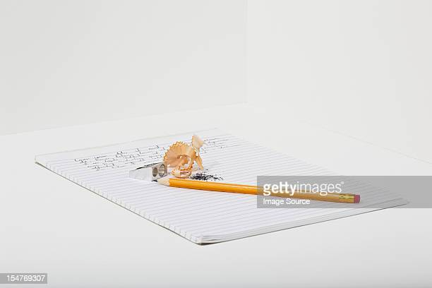 Notebook, pencil and pencil shavings