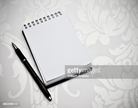 Notebook with pen, blank