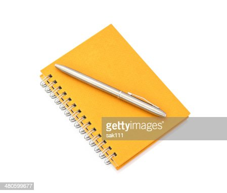 notebook with pen on white background : Stock Photo