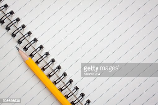 Notebooks and pencils : Stock Photo