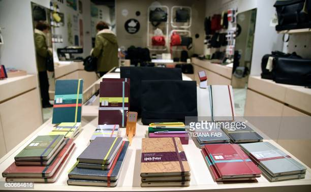 Notebooks of Italian notebook manufacturer Moleskine are laid out for sale in a store in central Rome on December 20 2016 The Italian group's sales...