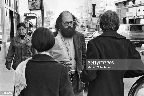 Noted beat poet Allen Ginsberg chats with some hippies on a streetcorner in San Francisco California on May 4 1967