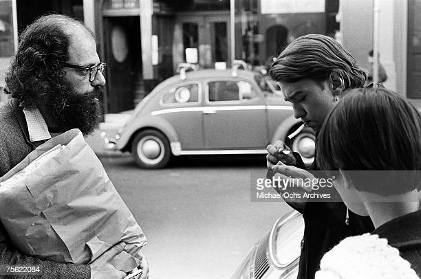 Noted beat poet Allen Ginsberg chats with some hippies on a streetcorner in San Francisco California in the early summer 1967