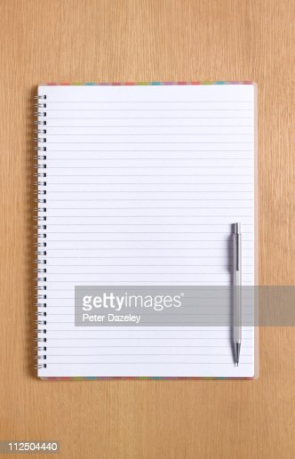 Notepad and pen with copy space