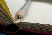 Notepad and pencil macro shot. Copy space for text.