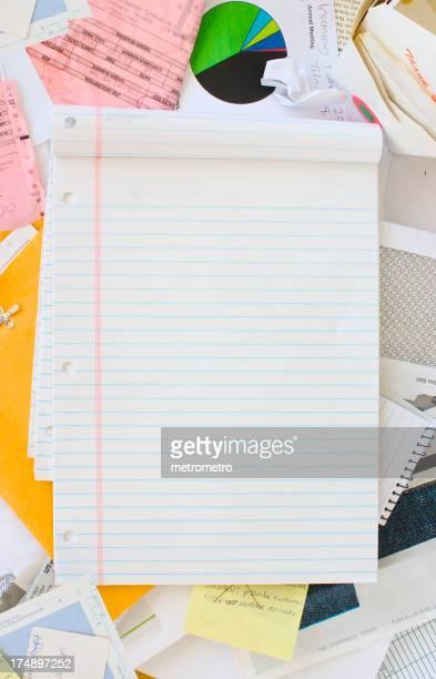 Notepad + messy desk