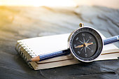 Notepad with compass wood background. Using wallpaper or background travel or navigator image.
