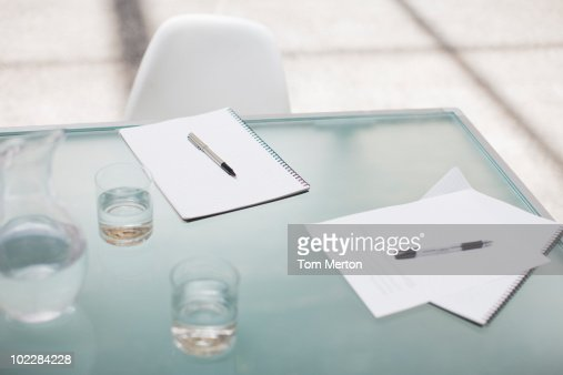Notepads and pens on conference table : Stock Photo