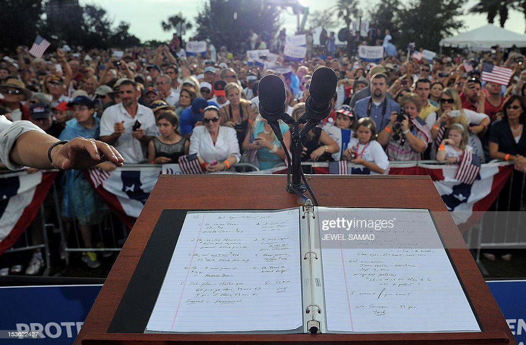 Notes are seen on the podium after US Republican presidential candidate Mitt Romney addressed supporters during a campaign rally in Port Saint Lucie, Florida, on October 7, 2012. US President Barack Obama's campaign intensified attacks Sunday on Romney's honesty as it tried to halt the Republican challenger's momentum after a strong first debate performance. Romney's people hit back, and did so sarcastically, depicting Obama's people as childish sore losers after he came across as flat, nervous and unassertive during their first face-to-face encounter in Denver, Colorado. AFP PHOTO/Jewel Samad