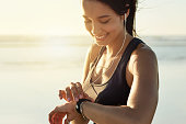 Cropped shot of an attractive and athletic young woman working out on the beach