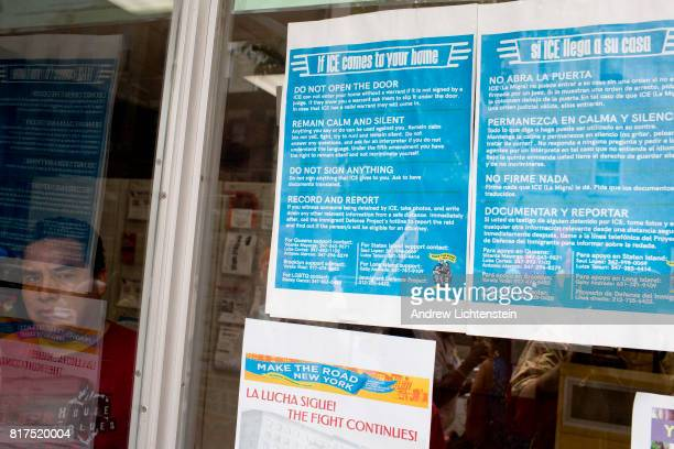A notice about what to do if being confronted by an ICE agent decorates the window of Make the Road NY a community activism center on July 15 2017 in...