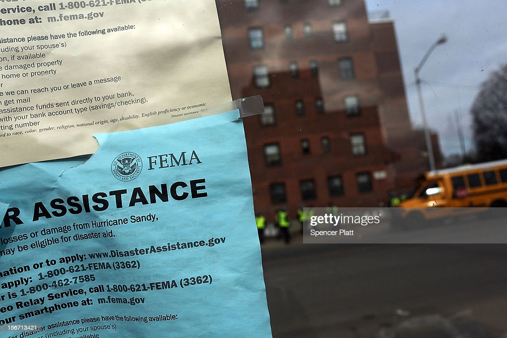 A notice from FEMA for assistance hangs on a window in the heavily damaged Rockaway neighborhood, where a large section of the iconic boardwalk was washed away on November 19, 2012 in the Queens borough of New York City. Three weeks after Superstorm Sandy slammed into parts of New York and New Jersey, thousands are still without power and heat.