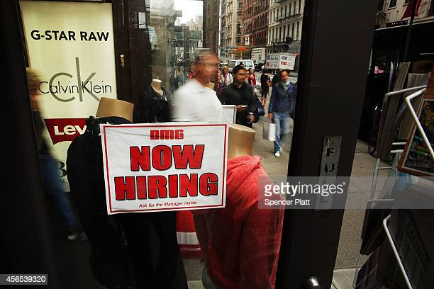 A notice in a store window announces a retail job opening on October 2 2014 in New York City In a sign that the labor market continues to improve new...