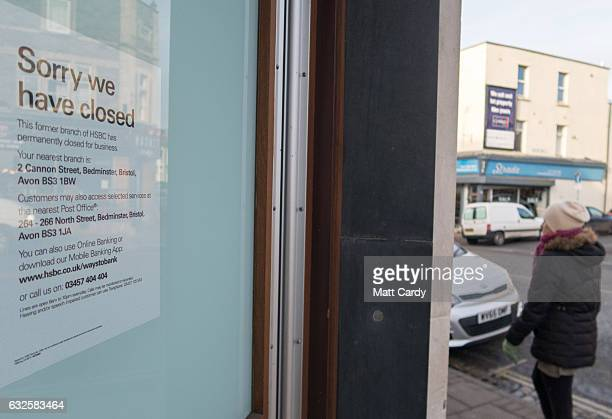 A notice of closure is displayed in a window of a closed branch of the HSBC bank on January 24 2017 in Bristol England High street lender HSBC has...